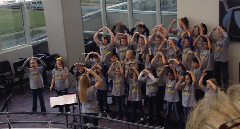 "WinterFest 2014 Sherwood Elementary ""Superstars"" Honors Choir performs on the promenade balcony"